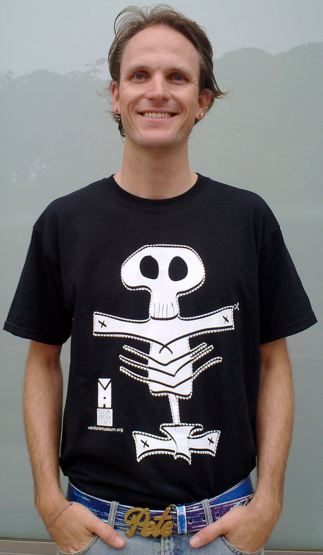 Artist Pete Ippel modeling the shirt he designed for the Dia de los Muertos event at the Museum of Ventura County